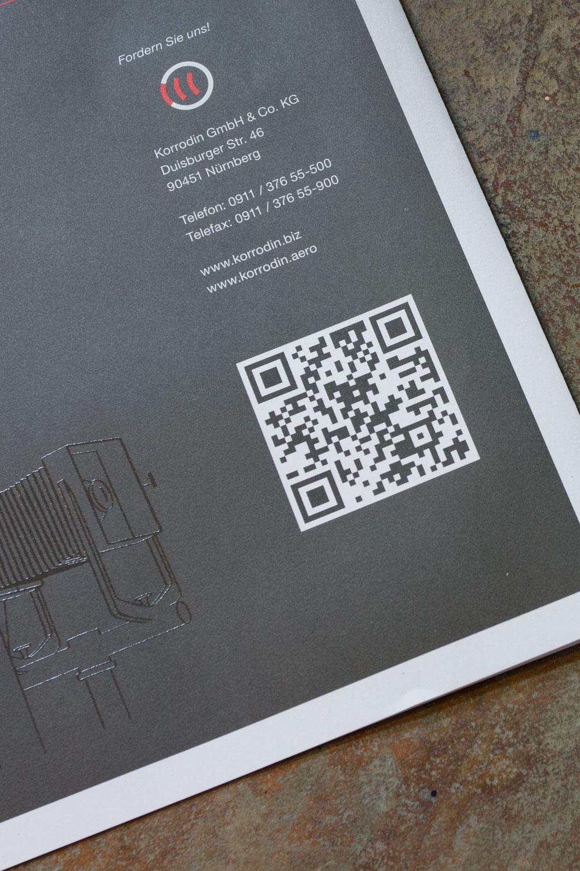Rückseite der aktuellen Ausgabe der Imagebroschüre mit QR-Code